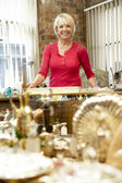 Female antique shop proprietor — Stock Photo