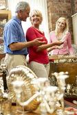 Couple shopping in antique shop — Stock Photo