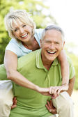 Mature couple having fun in countryside — Stock Photo