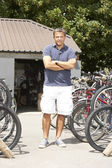 Owner of cycle shop in workshop — Stock Photo