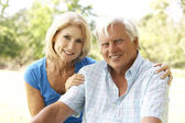 Portrait Of Senior Couple In Park — Stockfoto