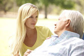 Senior Man Talking To Concerned Adult Daughter — Stock Photo