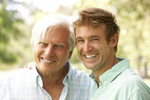 Portrait Of Senior Man With Adult Son — Stock Photo
