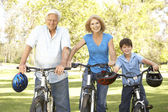 Grandparents And Grandson On Cycle Ride In Park — Stock Photo