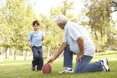 Grandfather And Grandson Playing American Football Together — Foto Stock