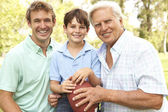 Grandfather With Father And Son Playing American Football Togeth — Stok fotoğraf