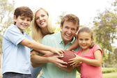 Family Playing American Football Together In Park — Foto Stock