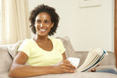 Woman Reading Book With Drink At Home — Stock Photo