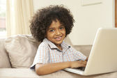Young Boy Using Laptop At Home — Foto Stock