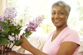Senior Woman Flower Arranging At Home — Stock Photo