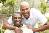 Senior Man Hugging Adult Son — Stock Photo