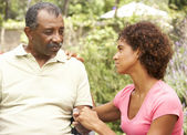 Senior Man Being Consoled By Adult Daughter — Stock Photo
