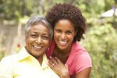 Senior Woman Hugging Adult Daughter — Stock Photo