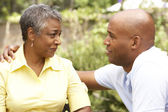 Senior Woman Being Consoled By Adult Son — Stock Photo