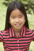 Portait Of Smiling Young Girl Outdoors — Stok fotoğraf