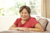 Senior Woman Relaxing In Chair At Home — 图库照片