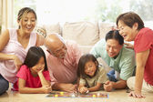 Extended Family Group Playing Board Game At Home — Stock Photo
