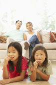 Two Children Eating Cookies At Home — Stockfoto