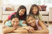 Young Family Relaxing At Home — 图库照片