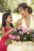 Mother And Daughter Gardening Together — Stok fotoğraf