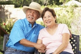 Senior Couple Relaxing In Garden Together — Stock Photo