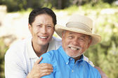 Senior Man With Adult Son In Garden — Stock Photo
