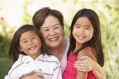 Grandmother With Grandchildren In Garden — Stock Photo