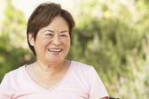 Smiling Senior Woman In Garden — Stockfoto