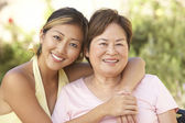 Senior Woman With Adult Daughter In Garden Together — Stock Photo
