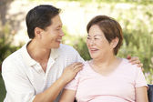 Senior Woman With Adult Son In Garden — Stock Photo