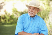 Senior Man Relaxing In Garden — Stock Photo