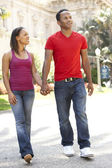 Young Couple Walking Through City Street — Stock Photo