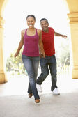 Young Couple Visiting Building In City — Stock Photo