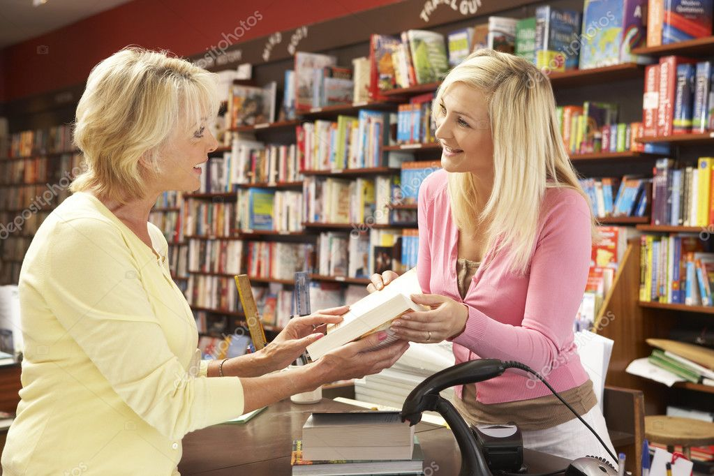 Female customer in bookshop  Stock Photo #4815508