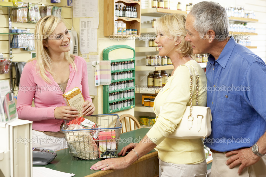 female  s assistant in health food store — stock photo    female  s assistant in health food store— photo by monkeybusiness