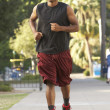 Young Man Jogging On Street — Stock Photo