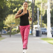 Young Woman Jogging On Street — Stock Photo