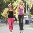 Stock Photo: Two Female Friends Jogging On Street