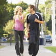Young Couple Jogging On Street — Stock Photo #4822204
