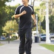 Young Man Jogging On Street - 