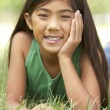Portrait Of Young Girl In Park - Stockfoto