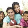 Family In Park With American Football — Stock Photo