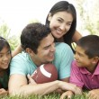 Family In Park With American Football — Stockfoto
