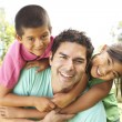 Father With Children In Park — Stock Photo