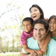 Young Family In Park — Stock Photo