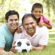 Grandfather With Son And Grandson In Park With Football — Stock Photo