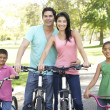 Royalty-Free Stock Photo: Young Family Riding Bikes In Park
