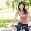 Young Woman Riding Bike In Park — 图库照片