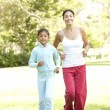 Mother And Daughter Exercising In Park — Stock Photo