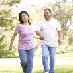 Senior Couple Running In Park — Stock Photo #4822395